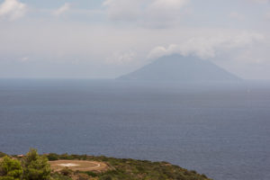 Sicily - Sunny impressions of the Aeolian Islands, also known as Aeolian Islands or Isole Eolie: Lipari, Stromboli, Salina, Vulcano, Panarea, Filicudi and Alicudi. Helipad on Panarea with a view of the Stromboli.
