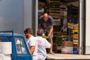 Sicily - Sunny impressions of the Aeolian Islands, also known as Aeolian Islands or Isole Eolie: Lipari, Stromboli, Salina, Vulcano, Panarea, Filicudi and Alicudi. Greengrocer with customers