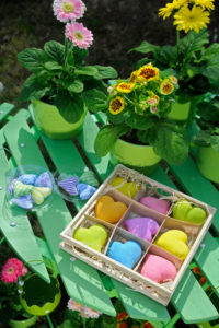 spring decoration with flowerpots and coloured hearts, close-up