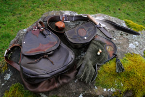 Falconer's equipment on a moss-covered stone arranges