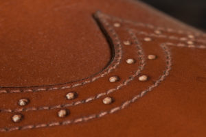 Leather shoe, handcrafted, close-up, seam, close-up