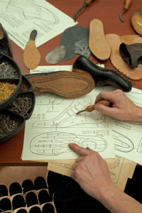 Shoemaker's workshop, drawing for tailor-made shoes, unfinished handcrafted shoe and soles, shoemaker, plan, foot, anatomy