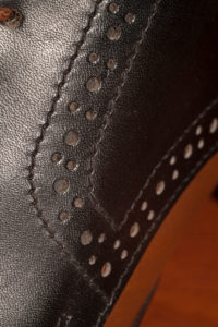 Handmade leather shoe, seam, detail, close-up