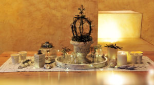 Christmas table decoration with fairy lights and candles
