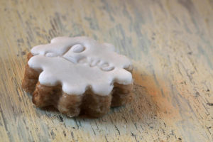Cookies with fondant coating, shabby chic background