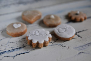 Cookies with heart and Love writing in close-up on white shabby chic background