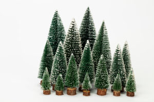 Miniature Christmas trees of different sizes, artificial, white background, icon image, Christmas time,