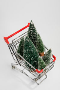 Miniature Christmas trees in the shopping cart, from above, white background, icon image, Christmas shopping,