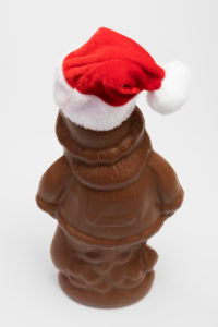 Unwrapped chocolate Santa Claus with Santa hat, from behind, white background, icon image, Christmas time,