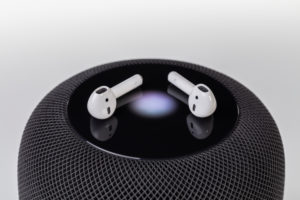 Apple, Apple HomePod, Apple AirPods 2, touch display lighting, Siri is active, wireless headphones, white background,