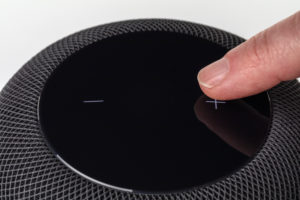 Apple HomePod, detail, finger, operate, touch control, white background,