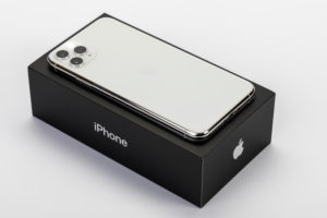 Apple iPhone 11 Pro Max on original packaging, back, three-camera system, flash, white background,