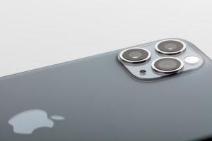 Apple iPhone 11 Pro Max, detail, back, three-camera system, flash, Apple company logo, white background,