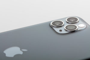 Apple iPhone 11 Pro Max, detail, back, three-camera system, flash, Apple company logo, white background,