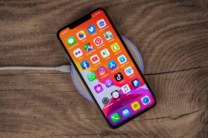 Apple iPhone 11 Pro Max lies on charging pad, wireless charging,