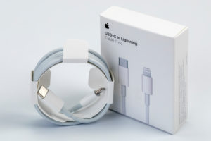 Apple USB-C on Lightning cable, original packaging, syncing, charging, white background,