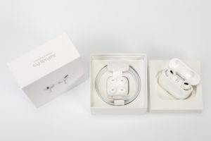 Apple AirPods Pro, original packaging opened, accessories, white background,