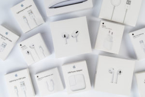 Apple accessories, various original packaging, EarPods, AirPods, Lightning cable, Power Adapter, Magic Mouse, white background,