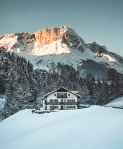 Farm in front of Hoher Göll in winter, district Berchtesgaden, Bavaria, Germany