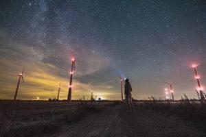 In the wind park under starry sky, near Haselünne, Lower Saxony, Germany