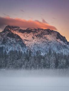 View above snow-covered Barmsee to the Karwendel mountains, Mittenwald, Werdenfelser Land, district Garmisch-Partenkirchen, Bavaria, Germany