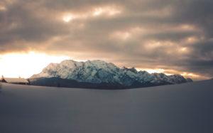 View above snow-covered landscape to Wetterstein Range, Mittenwald, Werdenfelser Land, district Garmisch-Partenkirchen, Bavaria, Germany