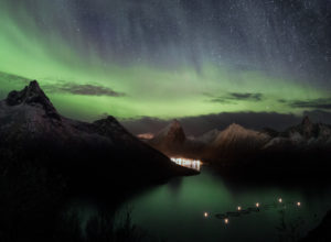 Northern lights over Fjordgård on Senja Island in Norway at night