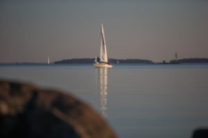 Yacht between the archipelago near Turku, Finland in sunset