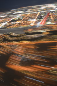 Blurred image of Las Vegas during aircraft take off