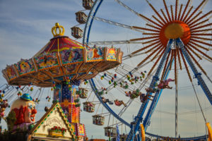 Europe, Germany, Bavaria, Munich, Oktoberfest, swing carousel and big wheel,