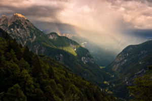 View into the valley of Trenta in majestic evening light with rainbow, Kanjavec summit, Mali Spicje, Velika Ticharica, Triglav National Park, Slovenia