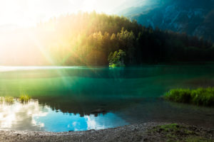 Lonely island in a mountain lake just before sunset, Tirol, Austria, Europe