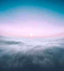 Germany, sunrise over the clouds
