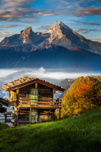 Idyllic mountain landscape in Bavaria, hut in front of Watzmann