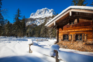 Winter dream in Bavaria, wooden hut