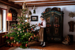 Christmas in an idyllic parlor, grandma in traditional costume
