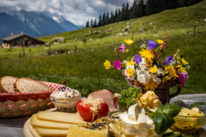 Quaint mountain pasture in the Alps, snack on the terrace, Berchtesgadener Land, Bavaria, Germany