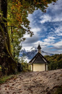 Watzmann in Berchtesgaden with chapel, Berchtesgaden, Berchtesgadener Land, Upper Bavaria, Bavaria, Germany, Germany, Alps, Mountains, Berchtesgadener Berge, architecture, little church, chapel, country road, autumn, clouds, Watzmann, deciduous trees, snow on the mountains. Path, Nobody, Landscape, Vacation, Vacation Destination