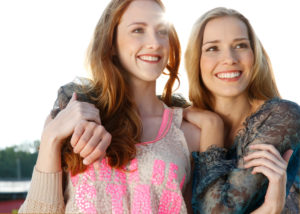 Two young women are happy and have fun, outdoor