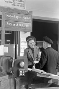 A female passenger with a customs officer at Berlin Tempelhof airport, Germany 1930s.
