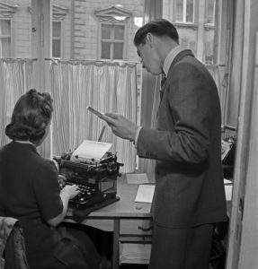 Apprentice doing administrational work at the office, Germany 1940s.