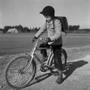 A school boy on his bicycle, Germany 1950s.