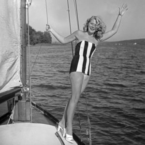 A young woman on a sailing boat wearing swimwear, Germany 1950s.