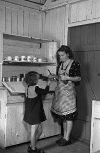 A woman doing her job in caring for the family in post war Germany, 1940s.