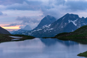 Germany, Bavaria, Allgäu, Oberstdorf, view over the Rappensee on the Walsertal mountains during the sunset