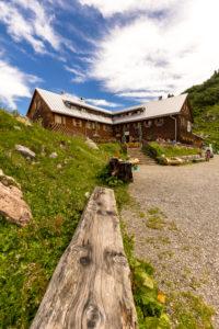 Austria, Vorarlberg, Lechquellen Mountains, Dalaas, wooden bank in front of the Freiburger Hütte
