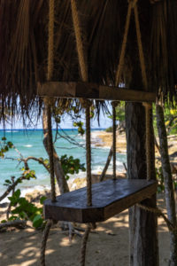 America, Caribbean, Greater Antilles, Dominican Republic, Cabarete, Decorative wooden shelf at the beach bar of the Natura Cabana Boutique Hotel & Spa