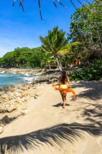 America, Caribbean, Greater Antilles, Dominican Republic, Cabarete, woman on the beach of the Natura Cabana Boutique Hotel & Spa