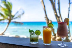 America, Caribbean, Greater Antilles, Dominican Republic, Cabarete, colorful cocktails against a beach backdrop at the Natura Cabana Boutique Hotel & Spa