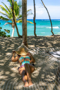 America, Caribbean, Greater Antilles, Dominican Republic, Cabarete, woman relaxing in a hammock at the Natura Cabana Boutique Hotel & Spa